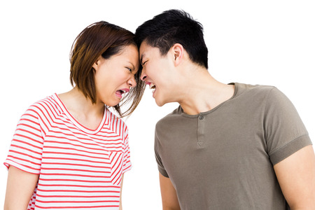 argument: Young couple into an argument on white background