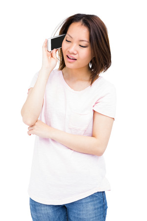 cut out device: Young woman talking on mobile phone on white background