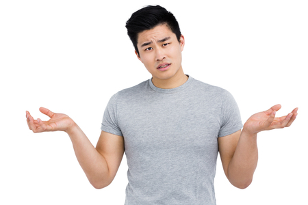 Portrait of worried man gesturing on white background