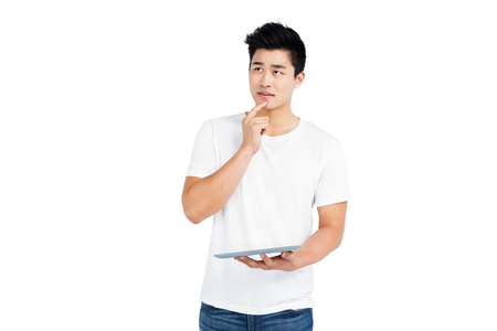 cut out device: Thoughtful young man holding digital tablet on white background
