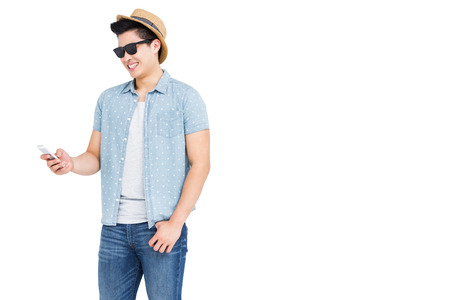 cut out device: Young man using mobile phone on white background