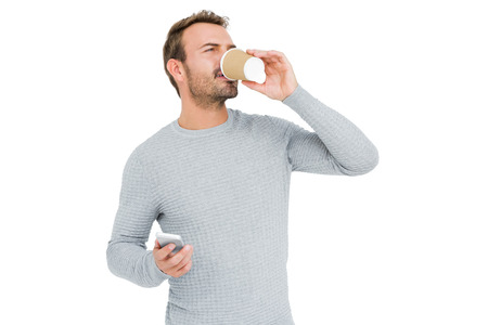 cut out device: Young man having coffee on white background