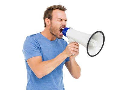 man shouting: Young man shouting on horn loudspeaker on white background Stock Photo