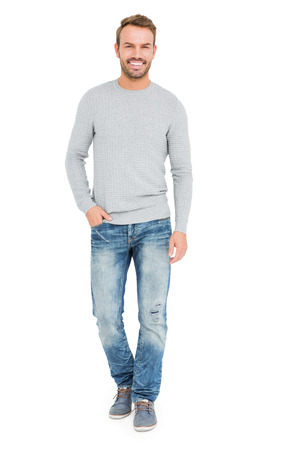cool man: Young man standing with hands in pocket on white background Stock Photo