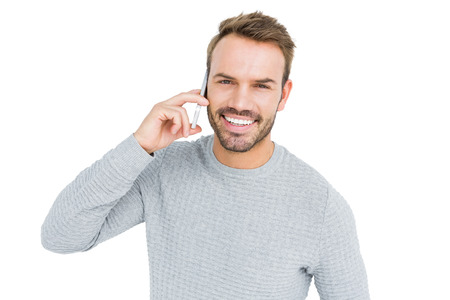 cut out device: Young man talking on mobile phone on white background