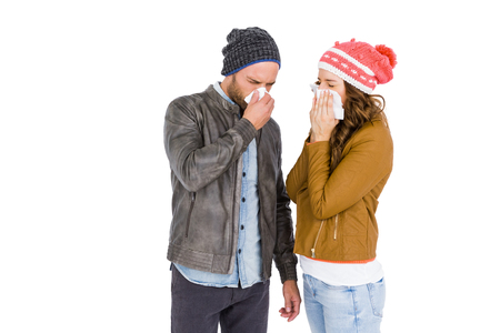 blowing nose: Sick young couple blowing nose on white background