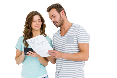 calculating: Worried couple calculating bill on calculator on white background