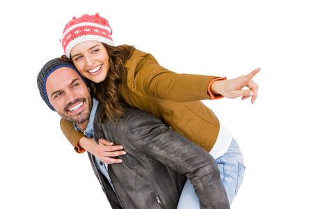 white playful: Man giving piggyback ride to woman on white background