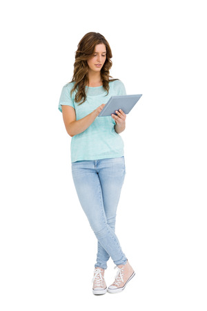 cut out device: Young woman using digital tablet on white background
