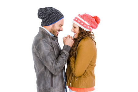 warm cloth: Young couple in warm cloth standing face to face and shivering on white background