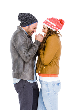 face cloth: Young couple in warm cloth standing face to face and shivering on white background