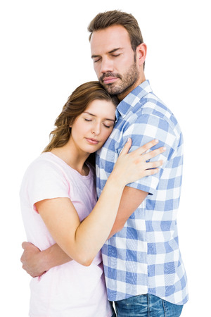 each: Happy young couple cuddling each other on white background