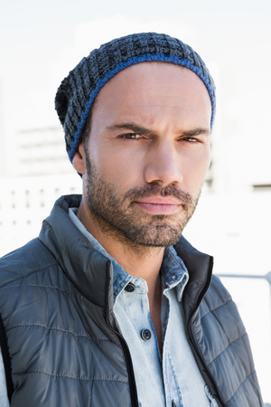 beanie: Portrait of confident young man wearing beanie hat and jacket