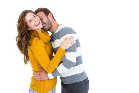 each other: Happy young couple cuddling each other on white background