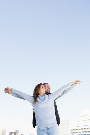 outstretched: Happy couple standing with arms outstretched Stock Photo