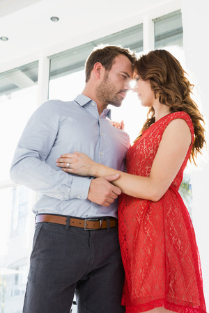 each other: Romantic young couple looking at each other and embracing