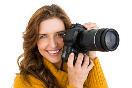 Woman photographing with camera on white background Stock Photo