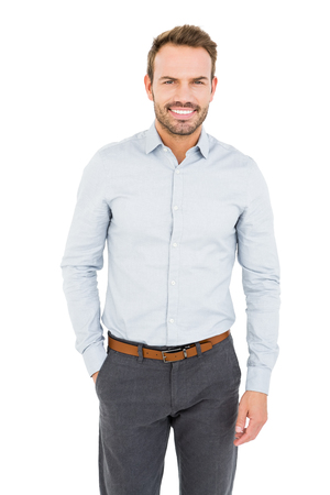 well dressed: Confident and well dressed young man smiling at camera on white background Stock Photo