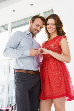 Romantic young couple holding hands