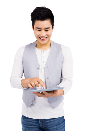 cut out device: Young man using digital tablet on white background Stock Photo