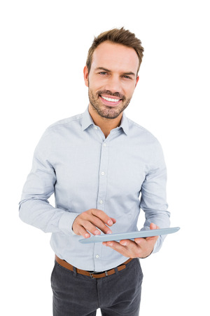 cut out device: Portrait of young man using digital tablet on white background
