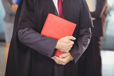 counsel: Lawyer holding a law book in office
