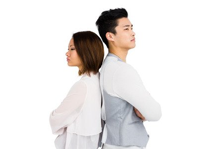 female clothing: Depressed couple standing back to back on white background