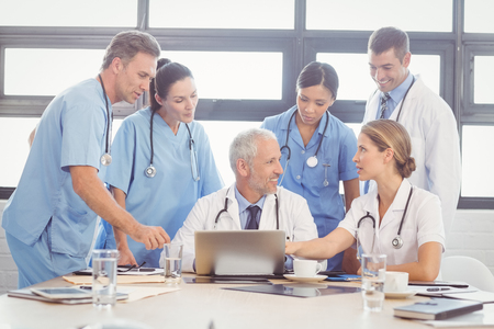 interacting: Medical team interacting at a meeting in conference room Stock Photo