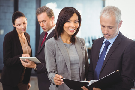people interacting: Team of business people interacting in office Stock Photo