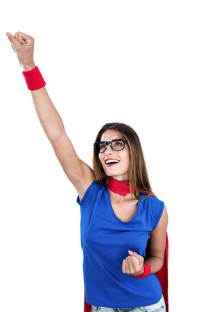 light hair: Smiling woman in superhero costume with arm raised on white background Stock Photo