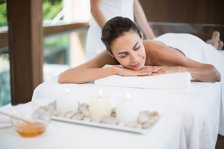 beauty shot: Young woman receiving massage from female masseur at health spa Stock Photo