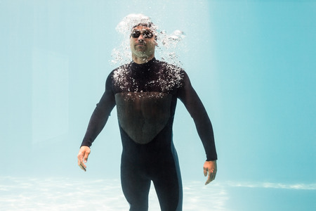 wetsuit: Young man wearing wetsuit while standing underwater
