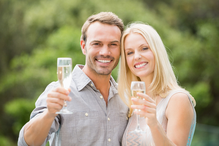 champagne flutes: Portrait of smiling couple holding champagne flutes Stock Photo