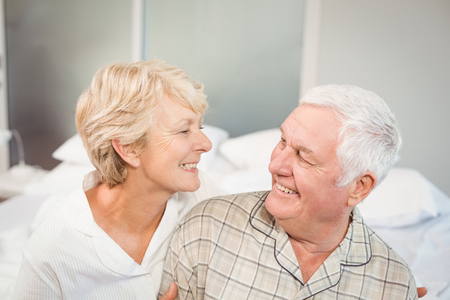 nightwear: High angle view of happy senior couple in nightwear on bed Stock Photo