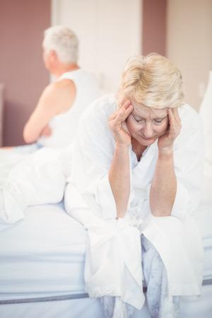 tensed: Tensed senior couple in bedroom at home