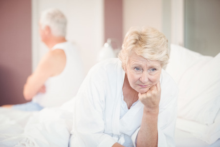 mature adult: Tensed senior couple on bed at home Stock Photo