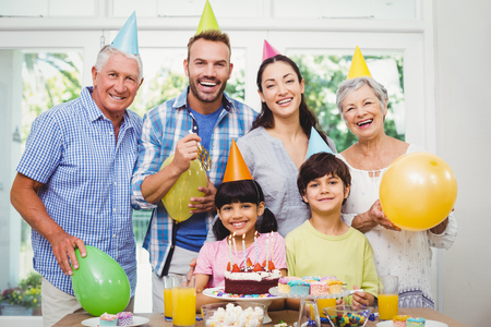 Portrait of happy multi generation family during birthday party at home Stock Photo