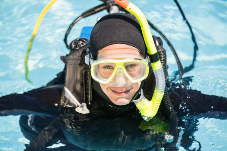 scuba woman: Portrait of young woman on scuba training in swimming pool