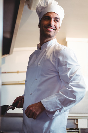 commercial kitchen: Chef holding his stove in commercial kitchen Stock Photo