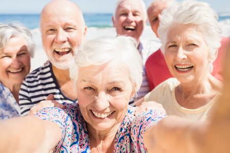 senior friends: Senior friends taking selfie on the beach