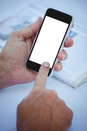 masculine: Close up of masculine hands using smartphone at a table