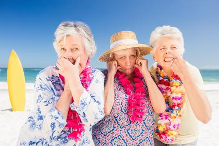grimacing: Senior woman doing grimace on the beach