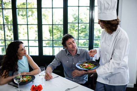 complaining: Couple complaining about the food to chef in a restaurant