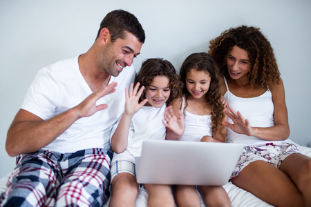 video chat: Family having video chat on laptop at home Stock Photo