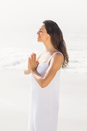 lotus position: Beautiful woman in lotus position on the beach Stock Photo