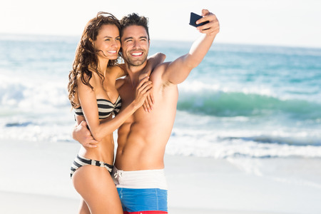 woman bike: Couple taking a selfie on a sunny day Stock Photo