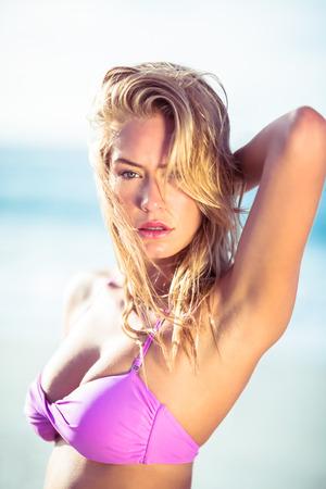 beach blond hair: Beautiful woman posing on the beach on a sunny day