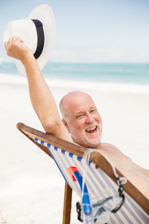 sunhat: Senior man holding his sunhat on a sunny day