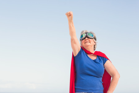 superwoman: Senior woman wearing superwoman costume on a sunny day Stock Photo