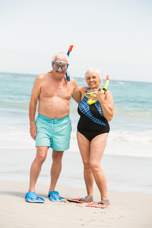 flippers: Senior couple wearing flippers on a sunny day